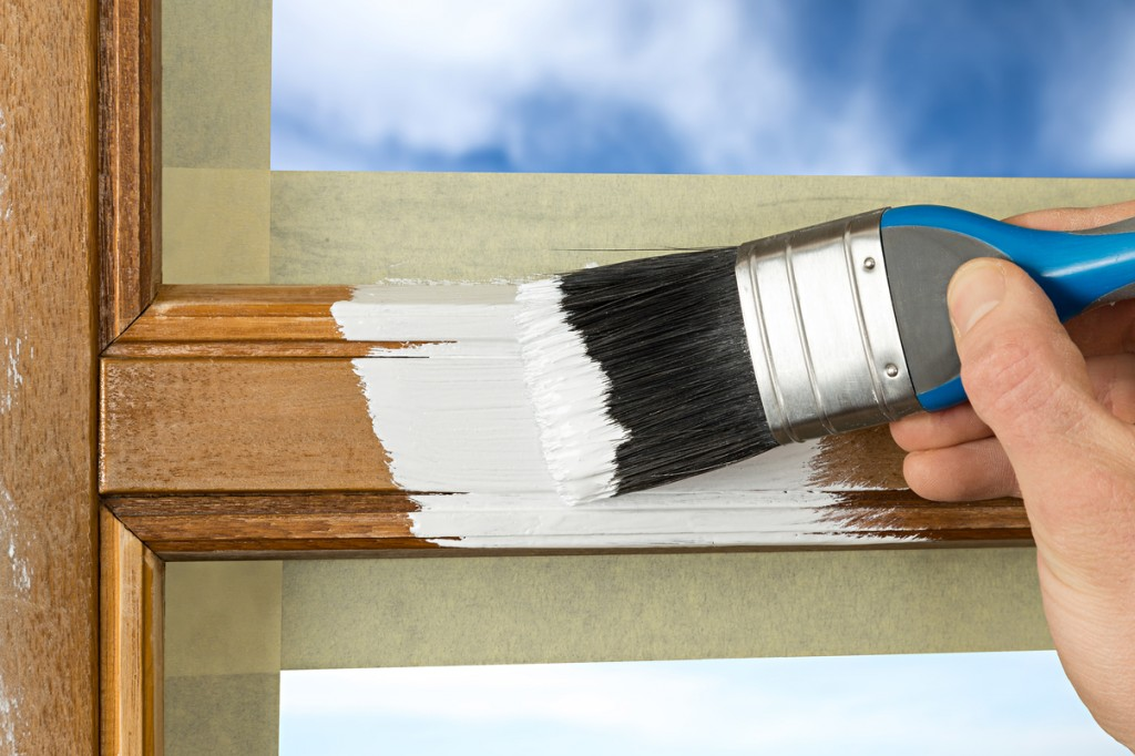 Painting a window frame with white color