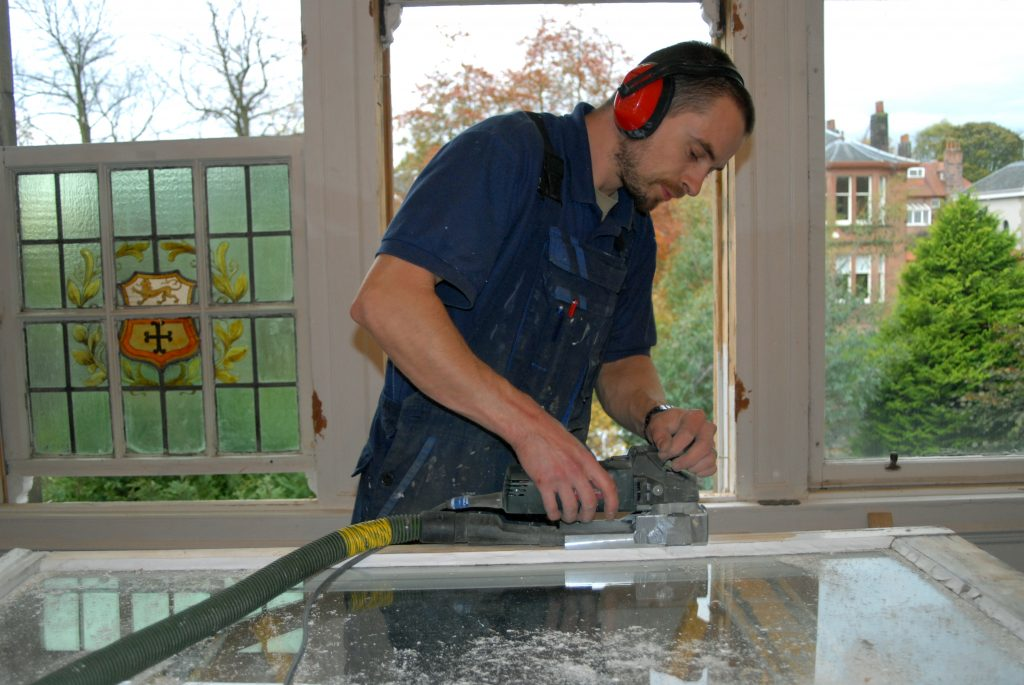 Man Working on Window