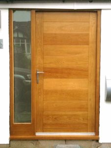 brown wooden door a better option than uPVC when considering wood vs upvc