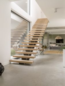 Wooden minimalistic stairs in pure big space